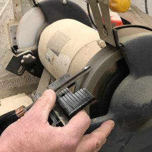 Sharpening a turning tool at the bench grinder